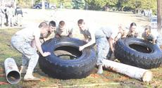 "<div class=""source""></div><div class=""image-desc"">The boys and girls teams get ready for the tire flip course, an event in strength competition. From left to right, boy's team: Eric Napier, team commander, Brandon Gouge, Cory Gray, Jonathon Gatewood; girl's team: Savannah Pelkey, Courtney Fernandez, Britany Kuhn and Kory Reed, team commander.</div><div class=""buy-pic""><a href=""/photo_select/8453"">Buy this photo</a></div>"
