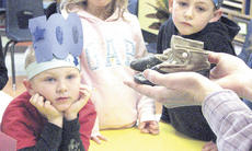 "<div class=""source"">Bryan Marshall</div><div class=""image-desc"">Williamstown Elementary kindergartener Brenden Trapp watches as his teacher Julie Kinsey holds baby shoes signifying 100-year old items.</div><div class=""buy-pic""><a href=""/photo_select/9002"">Buy this photo</a></div>"