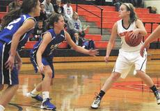 """<div class=""""source""""></div><div class=""""image-desc"""">The Lady Demons attempt to get the ball to the basket. File photo</div><div class=""""buy-pic""""><a href=""""/photo_select/19504"""">Buy this photo</a></div>"""