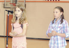 """<div class=""""source"""">Bryan Marshall, staff writer</div><div class=""""image-desc"""">Amber Tien, left, concentrates as she spells out a word, while Darcy Cummins thinks about the spelling of the word during the WES Spelling Bee. Tien came in first for fourth and fifth graders, while Cummins took second place.</div><div class=""""buy-pic""""><a href=""""/photo_select/5162"""">Buy this photo</a></div>"""