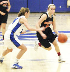 """<div class=""""source""""></div><div class=""""image-desc"""">Makayla Kennedy focuses as she dribbles into the lane against Simon Kenton in the first round of the district tournament. Photo by Wade Holland</div><div class=""""buy-pic""""><a href=""""/photo_select/19988"""">Buy this photo</a></div>"""
