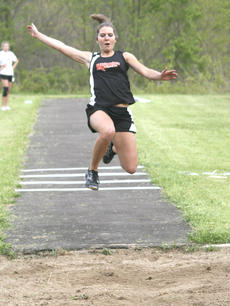 """<div class=""""source"""">Matt Birkholtz</div><div class=""""image-desc"""">Williamstown junior Alex Prokopchak flies through the air as she attempts her first triple jump of the Grant County All-Comers meet. Prokopchak finished in first place with a  measurement of 29 feet, 8 1/2 inches</div><div class=""""buy-pic""""><a href=""""/photo_select/14079"""">Buy this photo</a></div>"""
