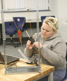 """<div class=""""source"""">Matt Birkholtz</div><div class=""""image-desc"""">Allison Vicars ties a censor to her block and tackle to set up a weighing of an item in an engineering class.</div><div class=""""buy-pic""""><a href=""""/photo_select/13192"""">Buy this photo</a></div>"""
