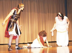 """<div class=""""source"""">Ryan Naus</div><div class=""""image-desc"""">The sentry, portrayed by Kyle Caldwell, has just caught Antigone burying her brother and has brought her before King Creon and the Choragos, played by Nikki Montgomery, to face judgement.</div><div class=""""buy-pic""""><a href=""""/photo_select/4122"""">Buy this photo</a></div>"""