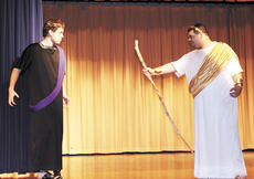 """<div class=""""source"""">Ryan Naus</div><div class=""""image-desc"""">Tieresias, portrayed by Daniel Coomer on the right, warns King Creon, played by Zac Bolen, that if he doesn't give in and bury Polyneices, the gods will punish him severely.</div><div class=""""buy-pic""""><a href=""""/photo_select/4124"""">Buy this photo</a></div>"""