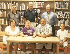 "<div class=""source"">Matt Birkholtz</div><div class=""image-desc"">Logan Barnett signs his national letter of intent to play collegiate soccer at Asbury University, Aug. 4 at Grant County High School. Pictured from left to right: Scott Shipp, Bill Simpkins, David Schmitt, Tracy Barnett, Logan Barnett, Tom Barnett and Matthew Barnett. Logan will be joining Roman Jaconette at Asbury this fall for the Eagles soccer team.</div><div class=""buy-pic""><a href=""http://web2.lcni5.com/cgi-bin/c2newbuyphoto.cgi?pub=195&orig=Barnett%2BSigning.jpg"" target=""_new"">Buy this photo</a></div>"