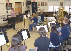 """<div class=""""source""""></div><div class=""""image-desc"""">Dave Owens, the first-year band director at GCHS, works with students.</div><div class=""""buy-pic""""><a href=""""/photo_select/5924"""">Buy this photo</a></div>"""