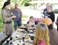 "<div class=""source"">Submitted</div><div class=""image-desc"">Bob Fraley talks about frontier lore, while showing off tools from frontier times.</div><div class=""buy-pic""><a href=""/photo_select/1793"">Buy this photo</a></div>"