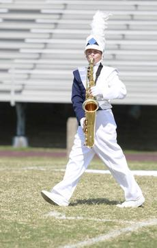 """<div class=""""source"""">Annette Crimmons</div><div class=""""image-desc"""">Brandon Wolfe struts his stuff during last week's band competition in Richmond.</div><div class=""""buy-pic""""></div>"""