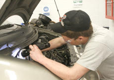 """<div class=""""source"""">Matt Birkholtz</div><div class=""""image-desc"""">Cameron Little is tightening the upper bolts on the strut for this Ford Windstar.</div><div class=""""buy-pic""""><a href=""""/photo_select/13193"""">Buy this photo</a></div>"""
