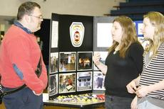 "<div class=""source""></div><div class=""image-desc"">As part of the Career Fair, Dry Ridge Fire Department firefighter and EMT Chance Carrig answers questions for students, Xena Smith and Makenzi Oliver.</div><div class=""buy-pic""><a href=""http://web2.lcni5.com/cgi-bin/c2newbuyphoto.cgi?pub=195&orig=Carrig-Smith-Oliver.jpg"" target=""_new"">Buy this photo</a></div>"