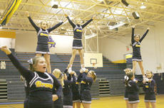 "<div class=""source"">Matt Birkholtz</div><div class=""image-desc"">The sixth grade cheerleaders perform during a timeout.</div><div class=""buy-pic""><a href=""/photo_select/8826"">Buy this photo</a></div>"
