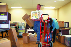 """<div class=""""source"""">Jamie Baker-Nantz</div><div class=""""image-desc"""">Chris Ammerman, extension agent for agriculture, moves boxes in the new extension office at 105 Baton Rouge Road.</div><div class=""""buy-pic""""><a href=""""/photo_select/7677"""">Buy this photo</a></div>"""