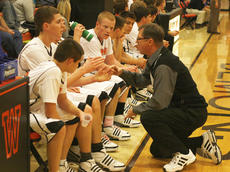 """<div class=""""source"""">Matt Birkholtz</div><div class=""""image-desc"""">Demons coach Steve Sigmon talks to his starters about not playing as a team. Sigmon said they played better after their discussion.</div><div class=""""buy-pic""""><a href=""""http://web2.lcni5.com/cgi-bin/c2newbuyphoto.cgi?pub=195&orig=Coach%2BSigmon.jpg"""" target=""""_new"""">Buy this photo</a></div>"""