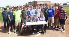 "<div class=""source""></div><div class=""image-desc"">Grant County senior baseball player Jordan Martin signed a letter of intent to attend Alderson-Broaddus College and play baseball. Jordan is pictured with his father Dallas and his mother Shell, Coach Darrin Robinson and the other members of the Grant County Braves baseball team. </div><div class=""buy-pic""></div>"