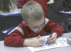 """<div class=""""source"""">Matt Birkholtz</div><div class=""""image-desc"""">Crittenden-Mt. Zion kindergartner, Brian Shepherd decorates the number 100 symbolizing the number of days the students have had this year.</div><div class=""""buy-pic""""><a href=""""/photo_select/13359"""">Buy this photo</a></div>"""