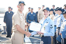 "<div class=""source""></div><div class=""image-desc"">Right, Naval Petty Officer 1st Class Kyle Conrad  receives an award aboard his ship the USS Sterett. National Honor Society students sent packages to Conrad and others on his ship.</div><div class=""buy-pic""></div>"
