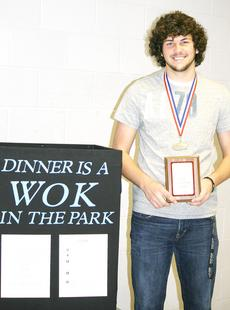 """<div class=""""source"""">Linda Lawrence</div><div class=""""image-desc"""">Cory Kearns won Silver for his frozen individual meal, 'Dinner is a WOK in the park.' </div><div class=""""buy-pic""""><a href=""""http://web2.lcni5.com/cgi-bin/c2newbuyphoto.cgi?pub=195&orig=Cory%2BKearns_2.jpg"""" target=""""_new"""">Buy this photo</a></div>"""