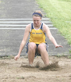"""<div class=""""source"""">Matt Birkholtz</div><div class=""""image-desc"""">Lady Braves sophomore Courtney Colson lands in the pit during a triple jump competition.</div><div class=""""buy-pic""""><a href=""""/photo_select/14078"""">Buy this photo</a></div>"""