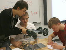 """<div class=""""source"""">Matt Birkholtz</div><div class=""""image-desc"""">Craig McLaughlin, Andy Engle and Isaiah Leonard work on using a first class lever and weighing an object over the lever during an engineering class at the Grant County High School Career and Technolgy Center</div><div class=""""buy-pic""""><a href=""""/photo_select/13195"""">Buy this photo</a></div>"""