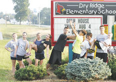 "<div class=""source"">Matt Birkholtz</div><div class=""image-desc"">Members and alumni of the Grant County High School cross country team pose in front of the Dry Ridge Elementary School sign during a game that consisted of them taking photos as they ran to different landmarks in the area.</div><div class=""buy-pic""><a href=""/photo_select/11551"">Buy this photo</a></div>"
