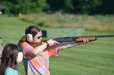 """<div class=""""source""""></div><div class=""""image-desc"""">Amber Gaskill takes aim and fires. The sisters live in Dry Ridge.</div><div class=""""buy-pic""""><a href=""""/photo_select/18133"""">Buy this photo</a></div>"""