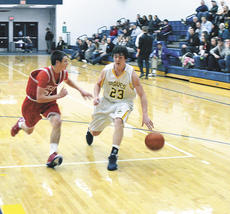 "<div class=""source""></div><div class=""image-desc"">Tyler Carr dribbles away from a St. Henry defender.</div><div class=""buy-pic""><a href=""/photo_select/16810"">Buy this photo</a></div>"