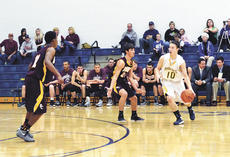 """<div class=""""source""""></div><div class=""""image-desc""""> The Grant County Braves rallied against the Bourbon County Colonels on Dec. 15 to get a win with a score of 73-50. Tyler Carr, above and right, scored 34 points. Bourbon County's Charles Johnson also had 34 points, but it wasn't enough to overcome the Braves' shooting and defense.Photos by Jerry Morris</div><div class=""""buy-pic""""><a href=""""/photo_select/16516"""">Buy this photo</a></div>"""