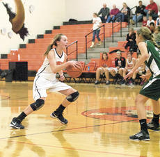 """<div class=""""source""""></div><div class=""""image-desc"""">Rachel Montgomery, a freshman, helped the Lady Demons to victory on Nov. 27 against Covington Latin. Right, Austin Taylor attemps to sink a layup as the Demons also won their first game of the season giving new coach Roger Harden his first win as a high school basketball coach. Photos by Haleigh Jacobs</div><div class=""""buy-pic""""><a href=""""http://web2.lcni5.com/cgi-bin/c2newbuyphoto.cgi?pub=195&orig=DSC_0257.jpg"""" target=""""_new"""">Buy this photo</a></div>"""