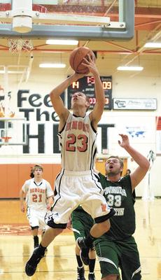 """<div class=""""source""""></div><div class=""""image-desc"""">Austin Taylor attemps to sink a layup as the Demons also won their first game of the season giving new coach Roger Harden his first win as a high school basketball coach. Photos by Haleigh Jacobs</div><div class=""""buy-pic""""><a href=""""http://web2.lcni5.com/cgi-bin/c2newbuyphoto.cgi?pub=195&orig=DSC_0291.jpg"""" target=""""_new"""">Buy this photo</a></div>"""