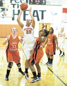 """<div class=""""source""""></div><div class=""""image-desc"""">Ashley Marksberry, a sophomore at WHS, splits two Paris Lady Greyhound defenders to drive for a basket. The Lady Demons beat the Lady Hounds 55-43. Photo by Haleigh Jacobs</div><div class=""""buy-pic""""><a href=""""/photo_select/16385"""">Buy this photo</a></div>"""