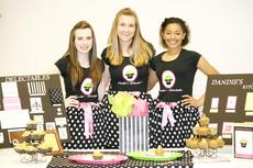"""<div class=""""source"""">Linda Lawrence</div><div class=""""image-desc"""">Olivia Cahill, Kendall Burk and Dana Liggett won Gold for their cupcake industry, Dandie's Delectables. </div><div class=""""buy-pic""""><a href=""""http://web2.lcni5.com/cgi-bin/c2newbuyphoto.cgi?pub=195&orig=Dandie%2527s_0.jpg"""" target=""""_new"""">Buy this photo</a></div>"""