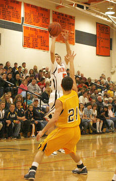 "<div class=""source"">Matt Birkholtz</div><div class=""image-desc"">Freshman David Jump shoots a three-point shot against Grant County Jan. 4.</div><div class=""buy-pic""><a href=""/photo_select/8884"">Buy this photo</a></div>"