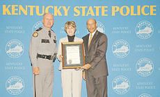 """<div class=""""source""""></div><div class=""""image-desc"""">Debbie Ward, center, accepted the Governor's Medal of Valor on behalf of her brother-in-law, the late KSP Trooper Joe Ward, right, from Justice and Public Safety Secretary Michael J. Brown and KSP Commissioner Rodney Brewer.</div><div class=""""buy-pic""""></div>"""