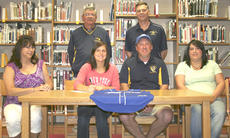 """<div class=""""source"""">Jamie Baker-Nantz</div><div class=""""image-desc"""">Grant County High School senior Erica Stith signed her national letter of intent to play softball at Thomas More College May 11 in the library.  </div><div class=""""buy-pic""""><a href=""""/photo_select/14227"""">Buy this photo</a></div>"""