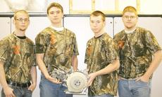 """<div class=""""source"""">Linda Lawrence</div><div class=""""image-desc"""">Chad Bedard, Damien Lucas, Kevin Banks and Devin Gordon, members of the Grant County High School Future Farmer's of America Agriculture Mechanics Team won the Northern Kentucky Regional Small Power and Equipment Contest. The team will move on to compete at the Kentucky State Fair in Louisville in August.</div><div class=""""buy-pic""""><a href=""""/photo_select/9975"""">Buy this photo</a></div>"""
