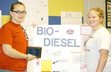 """<div class=""""source"""">Linda Lawrence</div><div class=""""image-desc"""">Tiffany Gerretson and Mattie Kuechler, students at Grant County High School, won first place in the Agriscience Demonstration Technology Category for their study on bio-diesel applications. Kuechler also won first place for auctioneering.</div><div class=""""buy-pic""""><a href=""""/photo_select/10166"""">Buy this photo</a></div>"""