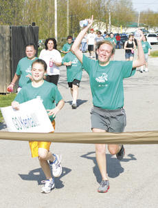 "<div class=""source"">Matt Birkholtz</div><div class=""image-desc"">Crittenden-Mt. Zion Elementary fifth grader Kendall Clemons finishes the practice 5K with her running partner, Grant County High School senior mentor Emily Puckett, April 14 at Grant County Park.</div><div class=""buy-pic""><a href=""http://web2.lcni5.com/cgi-bin/c2newbuyphoto.cgi?pub=195&orig=Girls%2BON%2Bthe%2BRun%2B5k.jpg"" target=""_new"">Buy this photo</a></div>"
