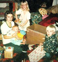 "<div class=""source"">Photo Submitted</div><div class=""image-desc"">The Roulette family poses for a photo after opening presents on Christmas morning.</div><div class=""buy-pic""></div>"
