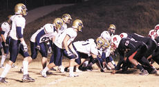 """<div class=""""source"""">Ryan Naus</div><div class=""""image-desc"""">The Braves defense prepares to keep John Hardin out of the end zone early in their playoff game. The Braves lost 55-7 and finished the season 7-4.</div><div class=""""buy-pic""""><a href=""""/photo_select/1820"""">Buy this photo</a></div>"""