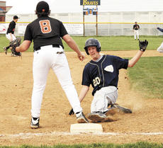 "<div class=""source"">Ryan Naus</div><div class=""image-desc"">Aaron Goe slides safely into third base.</div><div class=""buy-pic""><a href=""/photo_select/523"">Buy this photo</a></div>"