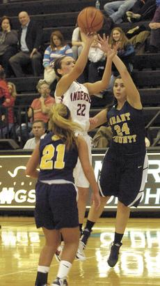 """<div class=""""source""""></div><div class=""""image-desc"""">Raven Wilson and Destiny Chaidez try to stop Eighth Region Player of the Year Makenzie Cann from scoring. Cann went on to score 24 points against the Lady Braves.</div><div class=""""buy-pic""""><a href=""""/photo_select/17178"""">Buy this photo</a></div>"""
