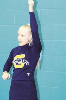 """<div class=""""source""""></div><div class=""""image-desc"""">Aprille Johnson cheers on the Grant County Braves.</div><div class=""""buy-pic""""><a href=""""/photo_select/17180"""">Buy this photo</a></div>"""
