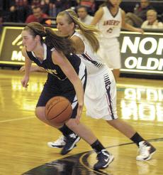 """<div class=""""source""""></div><div class=""""image-desc"""">Cierra Fannin drives against Kaci Currens on Feb. 28 in Oldham County. Anderson County rolled to a 64-31 win.</div><div class=""""buy-pic""""><a href=""""/photo_select/17182"""">Buy this photo</a></div>"""