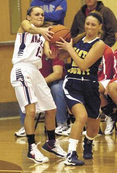 """<div class=""""source""""></div><div class=""""image-desc"""">Raven Wilson and Corrin Robinson battle for the ball during the Grant County Lady Braves matchup against Anderson County.</div><div class=""""buy-pic""""><a href=""""/photo_select/17184"""">Buy this photo</a></div>"""