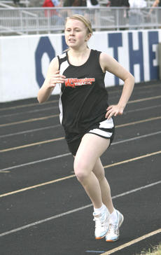 """<div class=""""source"""">Matt Birkholtz</div><div class=""""image-desc"""">Hannah Kinsey placed third  in the 800-meter run April 17, at Grant County High School with a time of 2:51.87.</div><div class=""""buy-pic""""><a href=""""/photo_select/14081"""">Buy this photo</a></div>"""