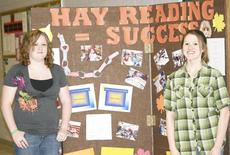 """<div class=""""source"""">Linda Lawrence</div><div class=""""image-desc"""">Taylor Gilbert and Kristin Warren won Gold at the FCCLA National Leadership Conference in California for their literacy project, Hay Reading.</div><div class=""""buy-pic""""><a href=""""http://web2.lcni5.com/cgi-bin/c2newbuyphoto.cgi?pub=195&orig=Hay%2BReading-third_0.jpg"""" target=""""_new"""">Buy this photo</a></div>"""