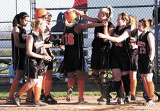 """<div class=""""source"""">Phyllis McLaughlin/Landmark News Service</div><div class=""""image-desc"""">Ashlee Holt is welcomed home by her teammates after hitting the team's first homerun of the season against Trimble County in the All """"A"""" tournament.</div><div class=""""buy-pic""""><a href=""""http://web2.lcni5.com/cgi-bin/c2newbuyphoto.cgi?pub=195&orig=Holt%2Bhomerun.jpg"""" target=""""_new"""">Buy this photo</a></div>"""