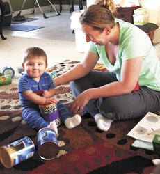 "<div class=""source""></div><div class=""image-desc"">Christina Hammer and her son, Cody, are participants in the HANDS program for early childhood development. They work weekly with Debbie Simpson, a registered nurse. Photos by Jamie Baker-Nantz</div><div class=""buy-pic""><a href=""http://web2.lcni5.com/cgi-bin/c2newbuyphoto.cgi?pub=195&orig=IMG_1743.jpg"" target=""_new"">Buy this photo</a></div>"