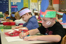 "<div class=""source"">Jamie Baker-Nantz</div><div class=""image-desc"">Rhett Boatman and Alexander Smith work on a Native American project in Mrs. Lyle's first grade class at DRE. </div><div class=""buy-pic""><a href=""/photo_select/10594"">Buy this photo</a></div>"